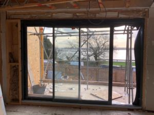 Luxury apartments looking out on to the water at Lilliput, wide windows with view